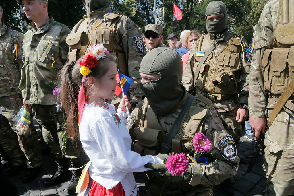 . Relatives and friends say goodbye to volunteers before they were sent to the eastern part of Ukraine to join the ranks of special battalion unit fighting against pro-Russian separatists, in Kiev, Ukraine, Tuesday, Aug. 26, 2014. It was the second straight day that attacks were reported in the vicinity of Novoazovsk, which is in eastern Ukraineís separatist Donetsk region but previously had seen little fighting between Ukrainian forces and pro-Russian rebels.  (AP Photo/Efrem Lukatsky)