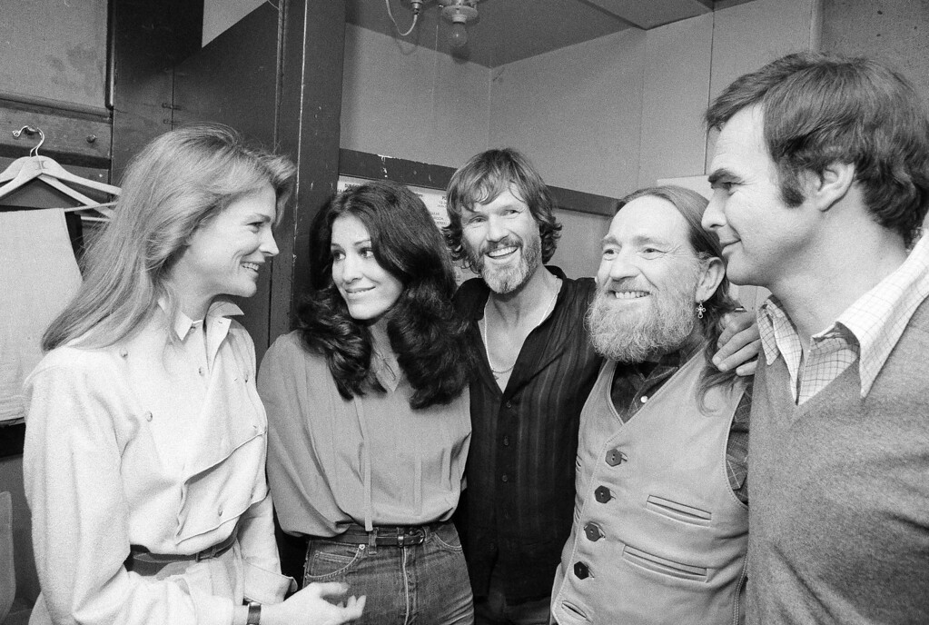 . From left to right:  actress Candice Bergen, singer Rita Coolidge, singer/songwriter Kris Kristofferson, country singer Willie Nelson, and actor Burt Reynolds are seen backstage at New York\'s Bottom Line after Coolidge and Kristofferson\'s opening night, Jan. 4, 1979.  (AP Photo/Richard Drew)