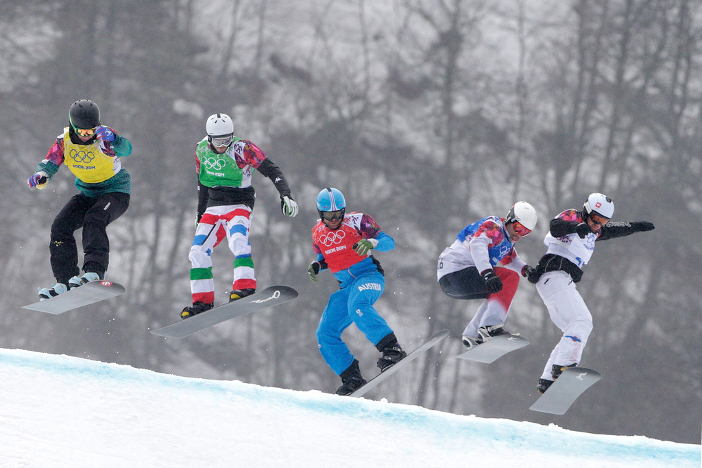. (L-R) Tim Watter of Switzerland (yellow bib), Luca Matteotti of Italy (green bib), Markus Schairer of Austria (red bib), Robert Fagan of Canada (blue bib) and Tim Watter of Switzerland (white bib) compete in the Men\'s Snowboard Cross 1/8 Finals on day eleven of the 2014 Winter Olympics at Rosa Khutor Extreme Park on February 18, 2014 in Sochi, Russia.  (Photo by Adam Pretty/Getty Images)