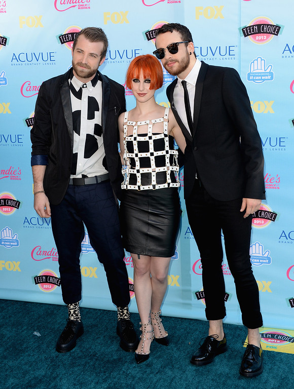 . UNIVERSAL CITY, CA - AUGUST 11:  (L-R) Musicians Jeremy Davis, Hayley Williams and Taylor York of Paramore attend the Teen Choice Awards 2013 at Gibson Amphitheatre on August 11, 2013 in Universal City, California.  (Photo by Jason Merritt/Getty Images)