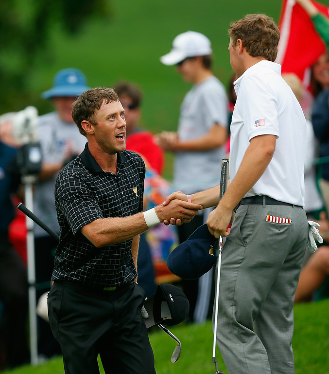 . Graham DeLaet of Canada and the International Team shakes hands with Jordan Spieth of the U.S. team after their match on the 18th hole during the Day Four Singles Matches at the Muirfield Village Golf Club on October 6, 2013  in Dublin, Ohio.  (Photo by Matt Sullivan/Getty Images)