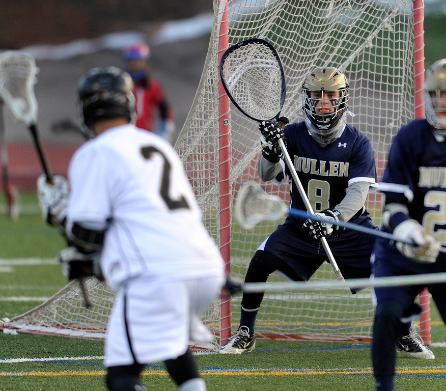 . LITTLETON, CO. - APRIL 10: Mustangs goalie Jason Cleary (8) watched the action in front of his net in the first half. The Mullen High School boy\'s lacrosse team defeated Arapahoe 8-7 Wednesday night, April 10, 2013. Photo By Karl Gehring/The Denver Post)