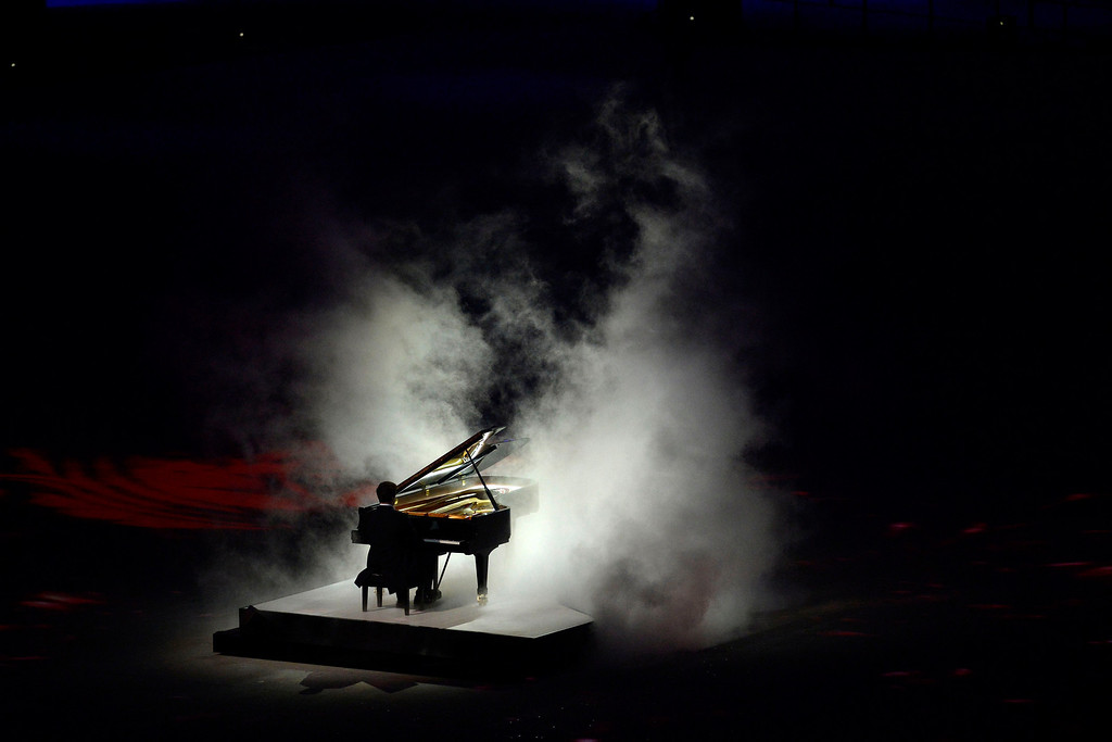 . A pianist performs an ode to Russia\'s rich history of musical composers during closing ceremony for the Sochi 2014 Winter Olympics. Sochi 2014 Winter Olympics on Sunday, February 23, 2014 at Fisht Olympic Stadium. (Photo by AAron Ontiveroz/ The Denver Post)