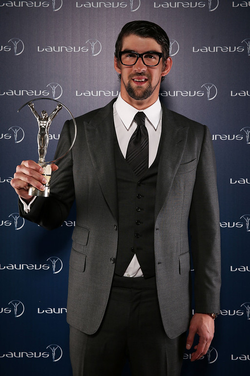 . Michael Phelps poses with the award for Laureus Academy Exceptional Achievement Award in the winners studio during the 2013 Laureus World Sports Awards at Theatro Municipal do Rio de Janeiro on March 11, 2013 in Rio de Janeiro, Brazil.  (Photo by Ian Walton/Getty Images For Laureus)