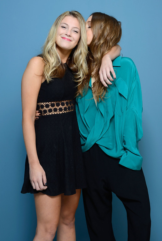 . Actress Zoe Levin and actress Sarah Sutherland of \'Beneath The Harvest Sky\' pose at the Guess Portrait Studio during 2013 Toronto International Film Festival on September 8, 2013 in Toronto, Canada.  (Photo by Larry Busacca/Getty Images)