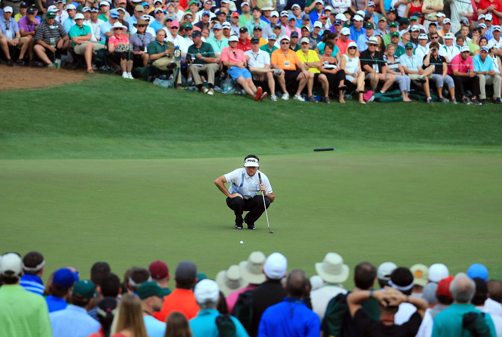 . Bubba Watson of the United States lines up a putt on the 16th green during the final round of the 2014 Masters Tournament at Augusta National Golf Club on April 13, 2014 in Augusta, Georgia.  (Photo by David Cannon/Getty Images)