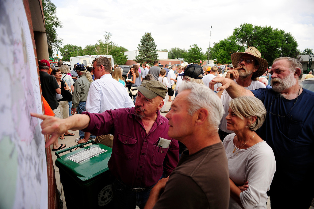 . Mike Hinmon (left) explains the map to Milo Trusty, while others look on as the High Park Fire continues to burn in the mountains west of Fort Collins on Monday, June 25, 2012. AAron Ontiveroz, The Denver Post
