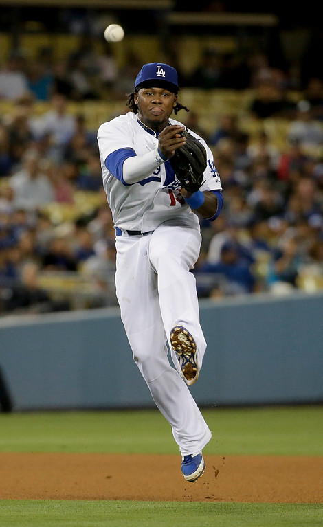 . Los Angeles Dodgers shortstop Hanley Ramirez throws Colorado Rockies\' Drew Stubbs out at first during fourth inning of a baseball game in Los Angeles, Wednesday, June 18, 2014. (AP Photo/Chris Carlson)