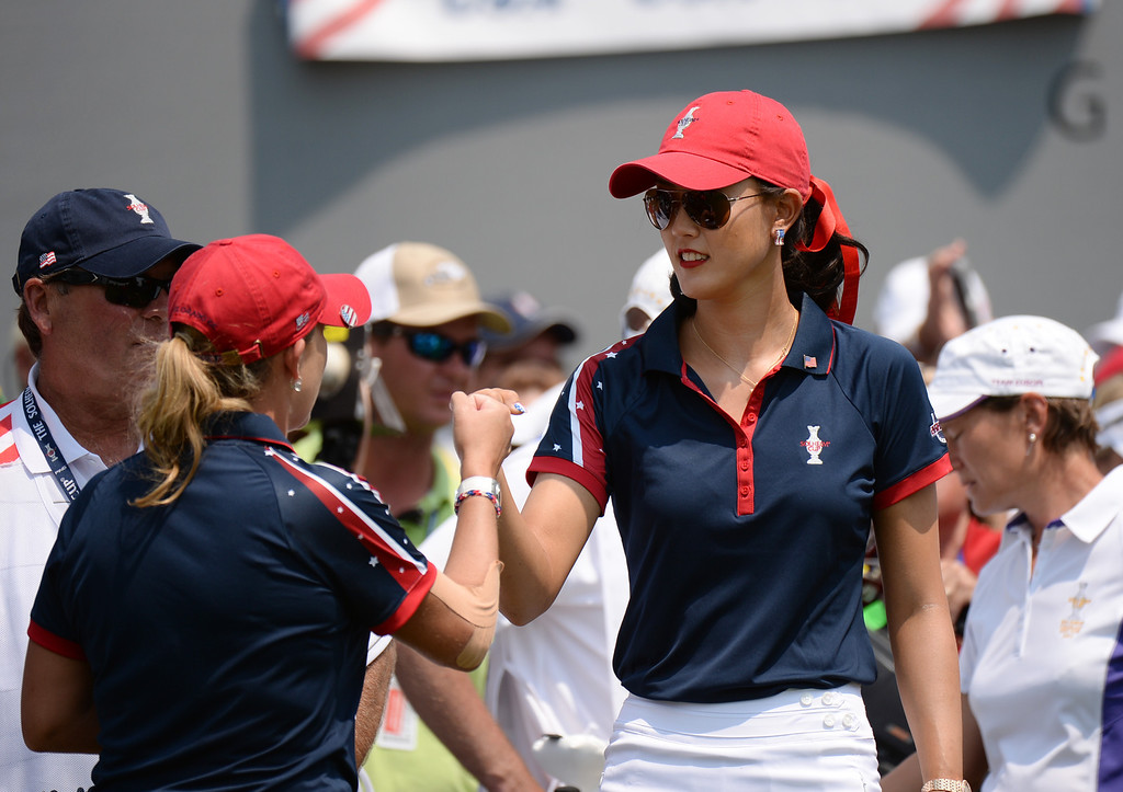. PARKER, CO. - August 16: Michelle Wie, right, and Cristie Kerr of team USA are on 1st tee ground during  2013 Solheim Cup at Colorado Golf Club. Parker, Colorado. August 16, 2013. (Photo By Hyoung Chang/The Denver Post)