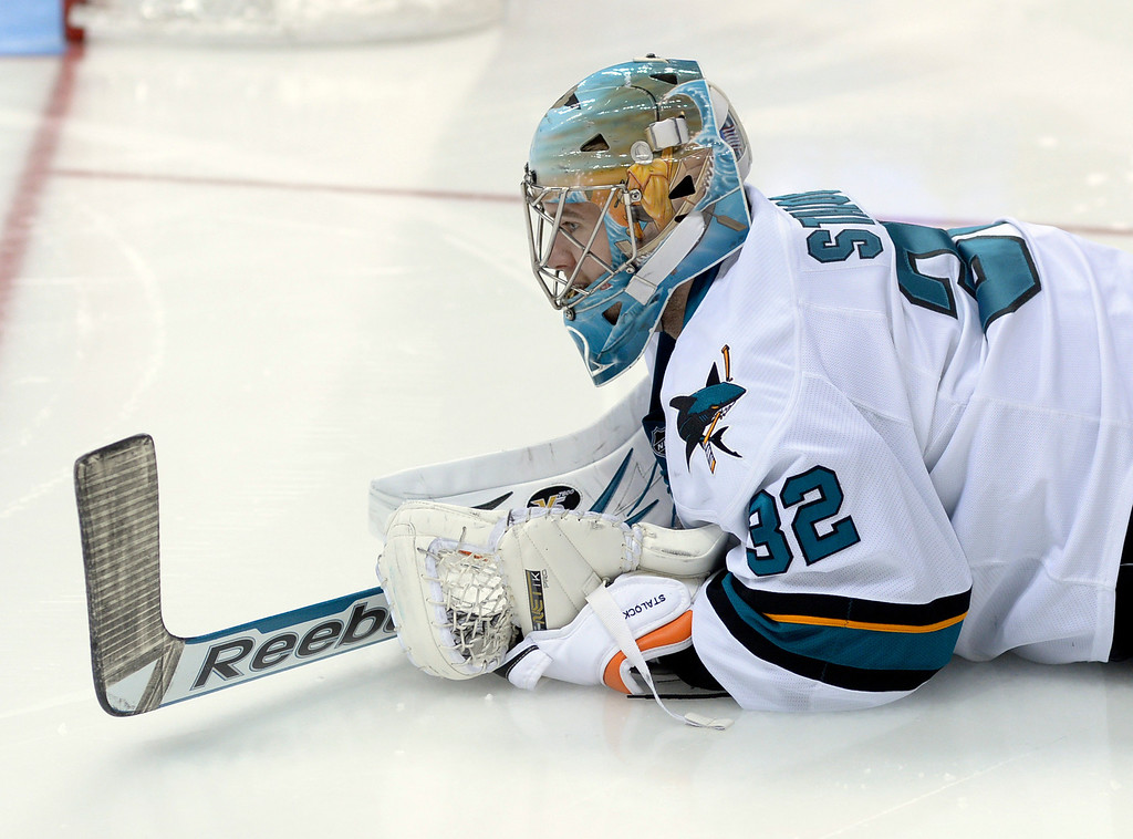 . DENVER, CO. - JANUARY 04:  Sharks goaltender Alex Stalock stretched out on the ice before the third period. The Colorado Avalanche defeated the San Jose Sharks 4-3 at the Pepsi Center Saturday afternoon, January 4, 2014. Photo By Karl Gehring/The Denver Post