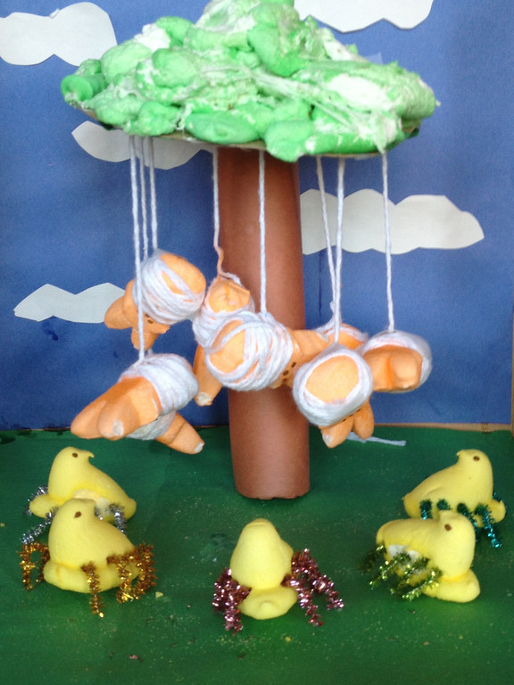 ". ""The Peepit: An unexpected journey\"" By Allie Kolpak, age eleven.  My diorama was inspired by the spider scene in The Hobbit: An unexpected journey. Bilbo and his friends are dangling from a tree by spider silk. Surrounding them are giant spiders."
