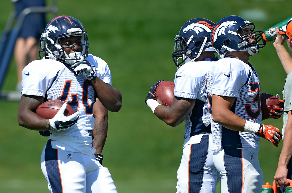 . Denver Broncos running back Juwan Thompson (40) runs through drills during practice at the Denver Broncos 2014 training camp August 11, 2014 at Dove Valley. (Photo by John Leyba/The Denver Post)