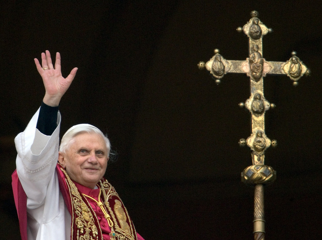. Germany\'s Joseph Ratzinger, the new Pope Benedict XVI, waves to crowd from the window of St Peter\'s Basilica\'s main balcony after being elected the 265th pope of the Roman Catholic Church 19 April 2005 at the Vatican City. PATRICK HERTZOG/AFP/Getty Images