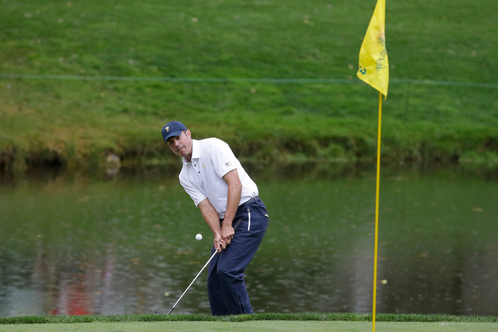. United States team player Matt Kuchar chips onto the third green during the single matches at the Presidents Cup golf tournament at Muirfield Village Golf Club Sunday, Oct. 6, 2013, in Dublin, Ohio. (AP Photo/Darron Cummings)