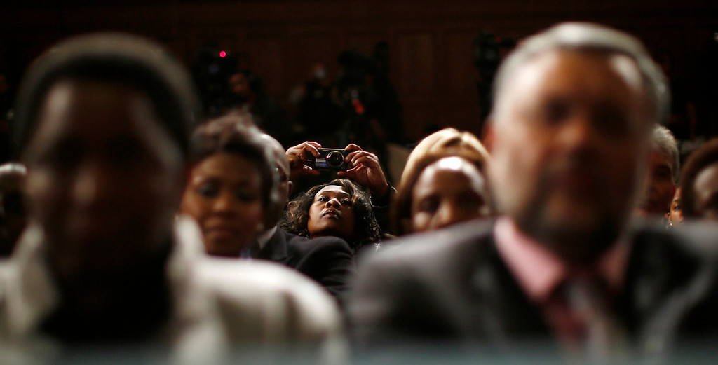 . A member of the audience takes a picture of U.S. President Barack Obama as he delivers remarks at the University of Cape Town in South Africa on June 30, 2013.   REUTERS/Jason Reed