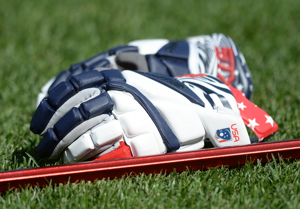 . COMMERCE CITY, CO - JULY 17: US attack Rob Pannell left his gloves on the field while the team warmed up Thursday before the game. Team USA faced Australia in a FIL World Championship semifinal game Thursday night, July 17, 2014.  Photo by Karl Gehring/The Denver Post