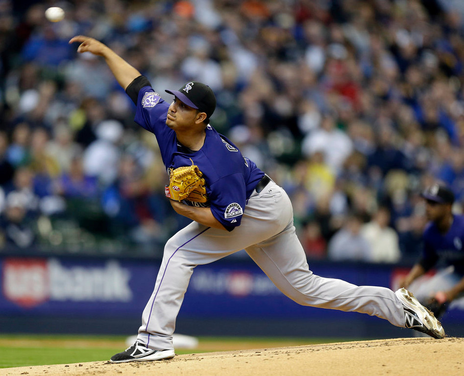 . Colorado Rockies starting pitcher Jhoulys Chacin throws to the Milwaukee Brewers in the first inning of an Opening Day baseball game Monday, April 1, 2013, in Milwaukee. (AP Photo/Jeffrey Phelps)