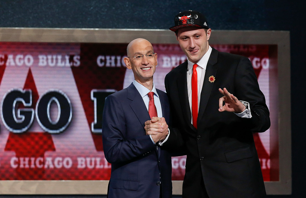 . Jusuf Nurkic of Bosnia-Herzegovina, right, poses for a photo with NBA commissioner Adam Silver after being selected as the 16th overall pick by the Chicago Bulls during the 2014 NBA draft, Thursday, June 26, 2014, in New York. Nurkic was then traded to the Denver Nuggets. (AP Photo/Kathy Willens)