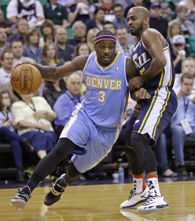 . Denver Nuggets\' Ty Lawson (3) drives around Utah Jazz\'s John Lucas III, right, in the first quarter during an NBA basketball game Monday, Nov. 11, 2013, in Salt Lake City.  (AP Photo/Rick Bowmer)
