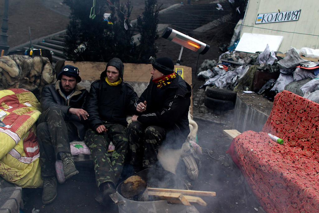 . Anti-Yanukovych protesters take a break at Independence Square, Kiev, Ukraine, Friday, Feb. 28, 2014. Russian military were blocking the airport in the Black Sea port of Sevastopol in Crimea near the Russian naval base while unidentified men were patrolling another airport serving the regional capital, Ukraine\'s new Interior Minister Arsen Avakov said on Friday. (AP Photo/Marko Drobnjakovic)