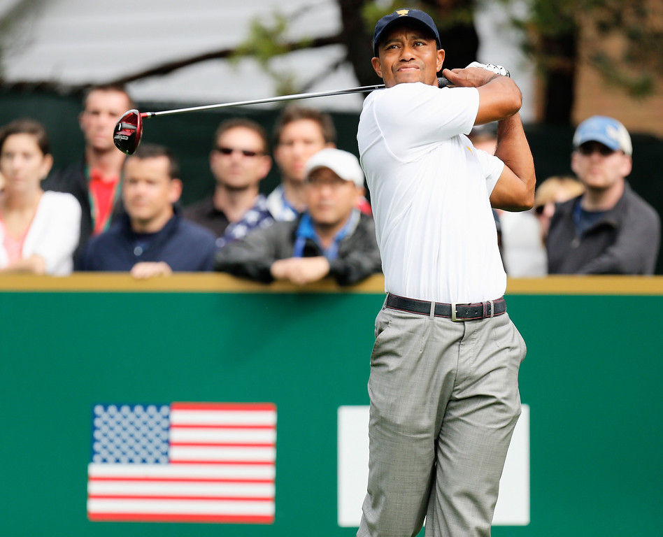. Tiger Woods of the U.S. Team hits his tee shot on the seventh hole during the Day Four Singles Matches at the Muirfield Village Golf Club on October 6, 2013  in Dublin, Ohio.  (Photo by Gregory Shamus/Getty Images)