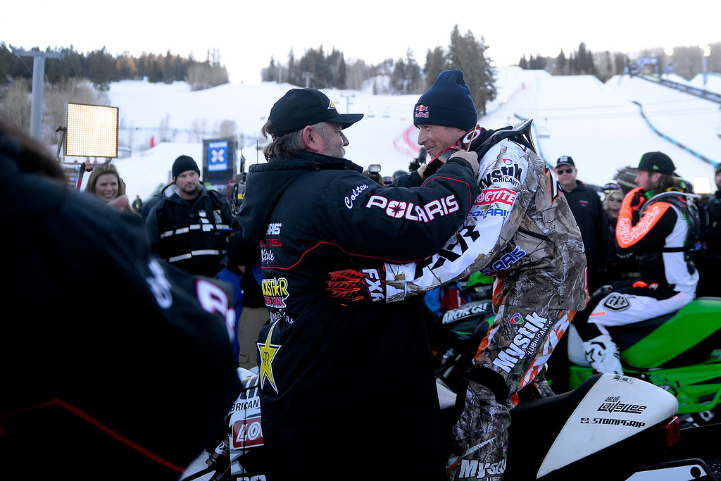 . ASPEN, CO - JANUARY 25: Wade Moore puts the gold medal around the neck of winner Levi LaVallee before a celebration for Moore\'s late son, Caleb, who was killed in the snowmobile freestyle event at the 2013 X Games Aspen. X Games Aspen at Buttermilk on Friday, January 25, 2014. (Photo by AAron Ontiveroz/The Denver Post)