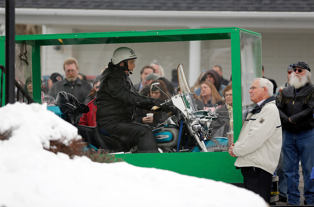 . The body of Bill Standley, secured to his 1967 Harley Davidson, rests inside a plexiglass box during his funeral service in Mechanicsburg, Ohio on Friday, Jan. 31, 2014.  Standley\'s family said he\'d been talking about it for years and liked to take people to the garage to show off the unusual casket his two sons had built for him. He told people he didn\'t just want to ride off to heaven, he wanted the world to see him do it in the big see-through box. (AP Photo/Columbus Dispatch, Jonathan Quilter)