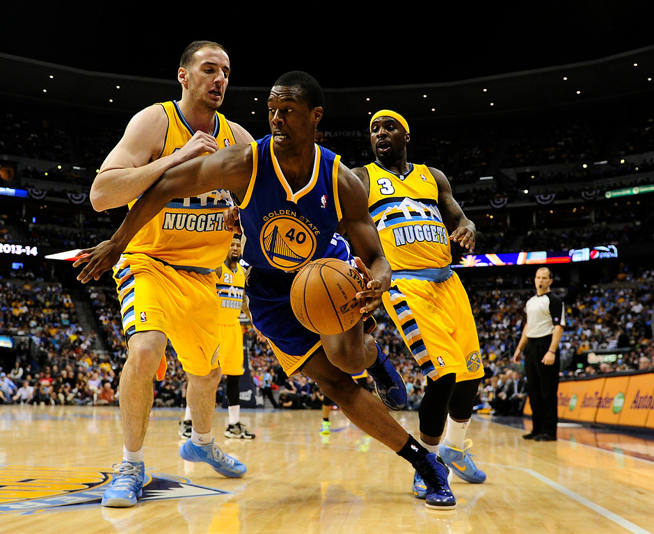 . DENVER, CO. - APRIL 23: Golden State Warriors small forward Harrison Barnes (40) is guarded by Denver Nuggets center Kosta Koufos (41) and Denver Nuggets point guard Ty Lawson (3) in the second quarter. The Denver Nuggets took on the Golden State Warriors in Game 2 of the Western Conference First Round Series at the Pepsi Center in Denver, Colo. on April 23, 2013. (Photo by AAron Ontiveroz/The Denver Post)