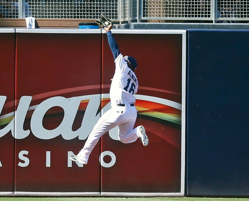 . San Diego Padres center fielder Abraham Almonte makes the leaping catch at the fence to rob Colorado Rockies\' Drew Stubbs in the first inning of a baseball game Wednesday, Aug. 13, 2014, in San Diego. (AP Photo/Lenny Ignelzi)