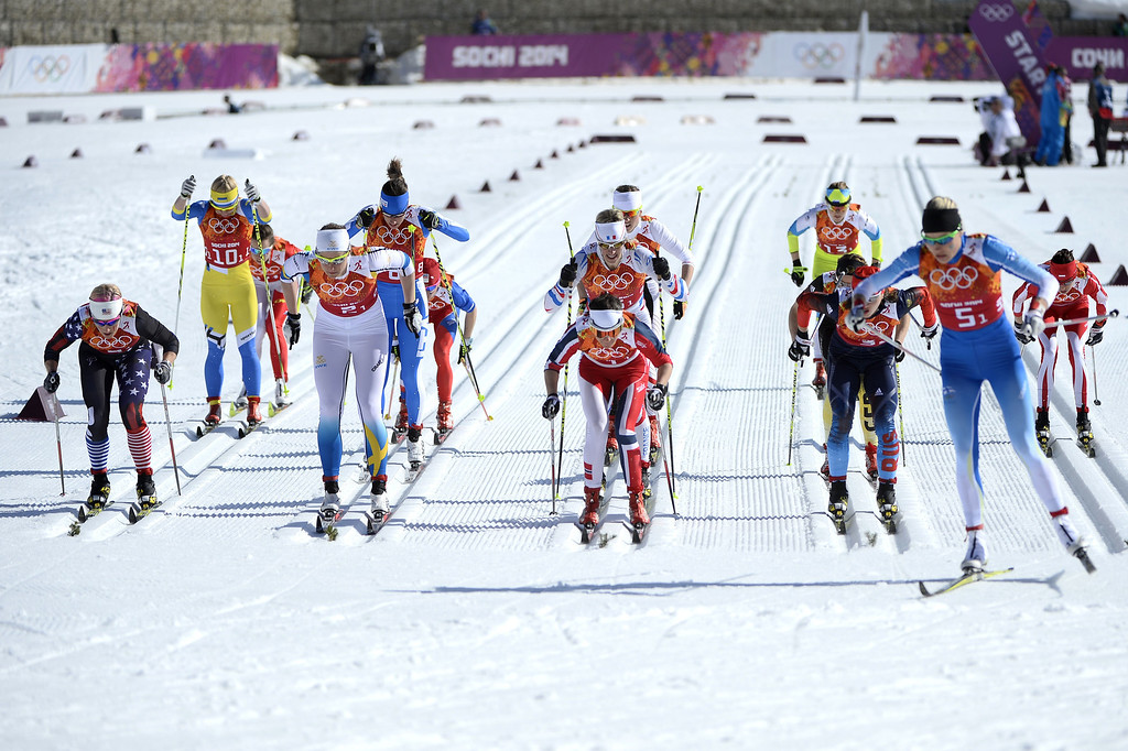 . Athletes start the Women\'s Cross-Country Skiing 4x5km Relay at the Laura Cross-Country Ski and Biathlon Center during the Sochi Winter Olympics on February 15, 2014, in Rosa Khutor, near Sochi. PIERRE-PHILIPPE MARCOU/AFP/Getty Images