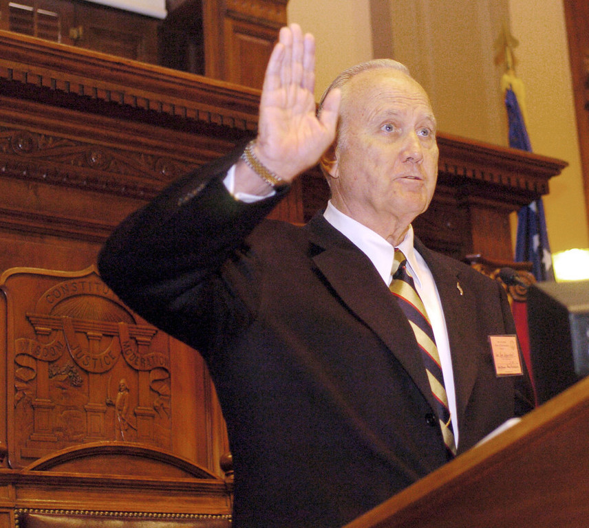 . Retired Army Gen. H. Norman Schwarzkopf waives from the well of the House during session, Thursday, March 23, 2006, at the Capitol in Atlanta. Schwarzkopf was recognized in a Senate resolution for his lifetime service to the nation. (AP Photo/Gregory Smith)