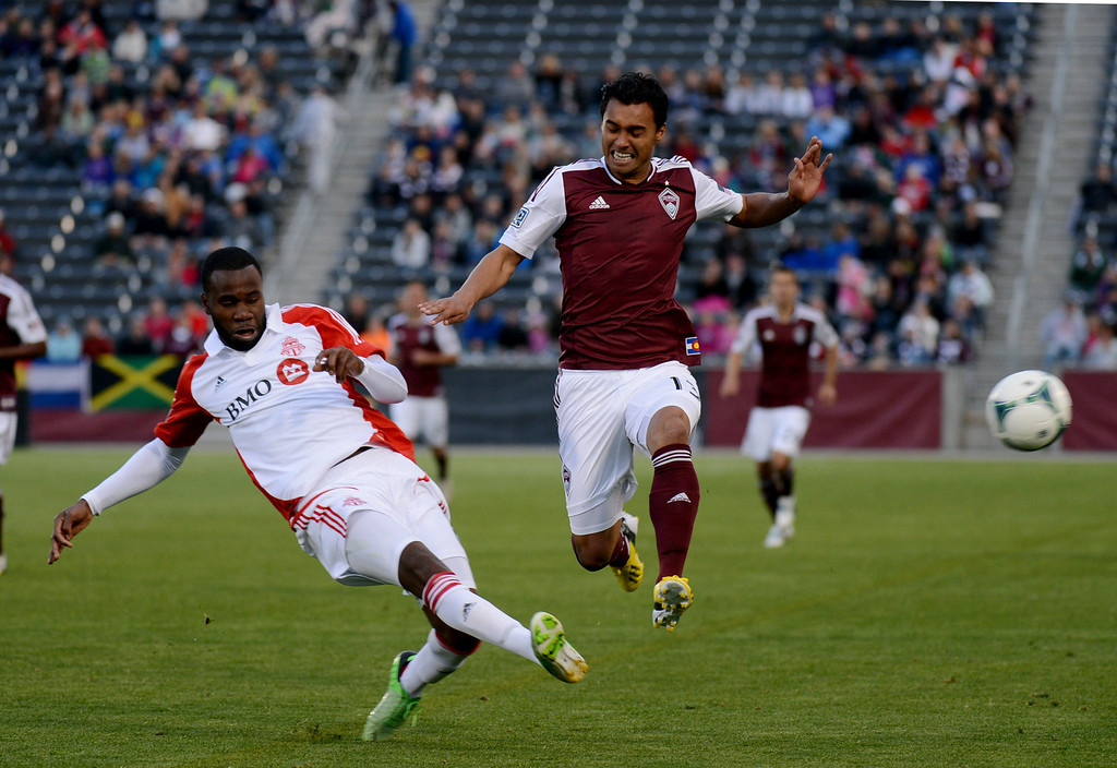 . COMMERCE CITY, CO. - MAY 04 : Kamani Hill #13 of Colorado Rapids and Gale Agbossoumonde #6 of Toronto FC are in action in the 1st half of the game at Dick\'s Sporting Goods Park in Commerce City, Colorado. May 4, 2013. (Photo By Hyoung Chang/The Denver Post)