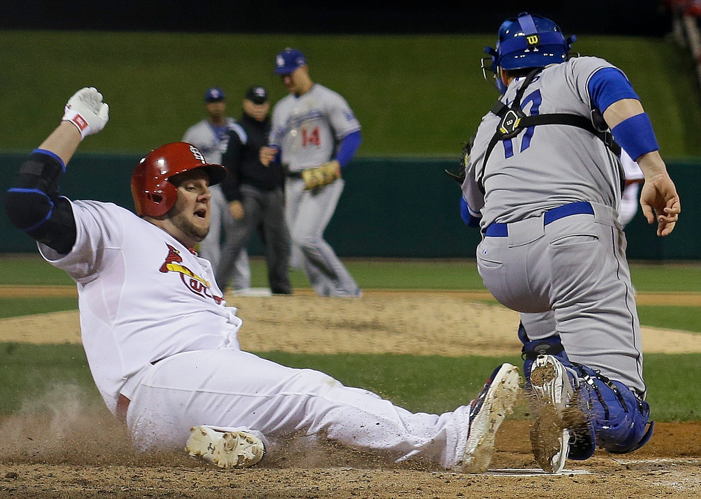 . St. Louis Cardinals\' Matt Adams slides safely past Los Angeles Dodgers catcher A.J. Ellis during the fifth inning of Game 6 of the National League baseball championship series, Friday, Oct. 18, 2013, in St. Louis. (AP Photo/David J. Phillip)