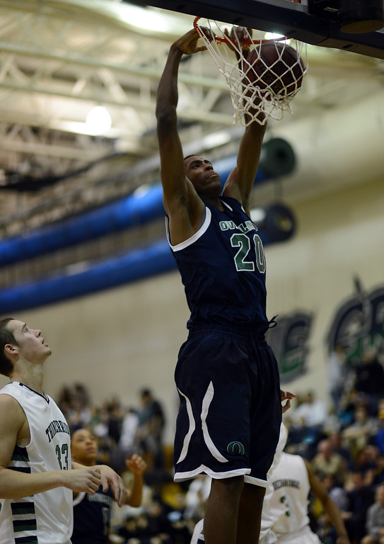 . HIGHLANDS RANCH, CO. - MARCH 02: De\'Ron Davis of Overland High School #20 dunks by Peter Howell of ThunderRidge High School #33 during the 2nd round of 5A playoff game at ThunderRidge High School. March 2, 2013. Highlands Ranch, Colorado. ThunderRidge won 67-57. (Photo By Hyoung Chang/The Denver Post)