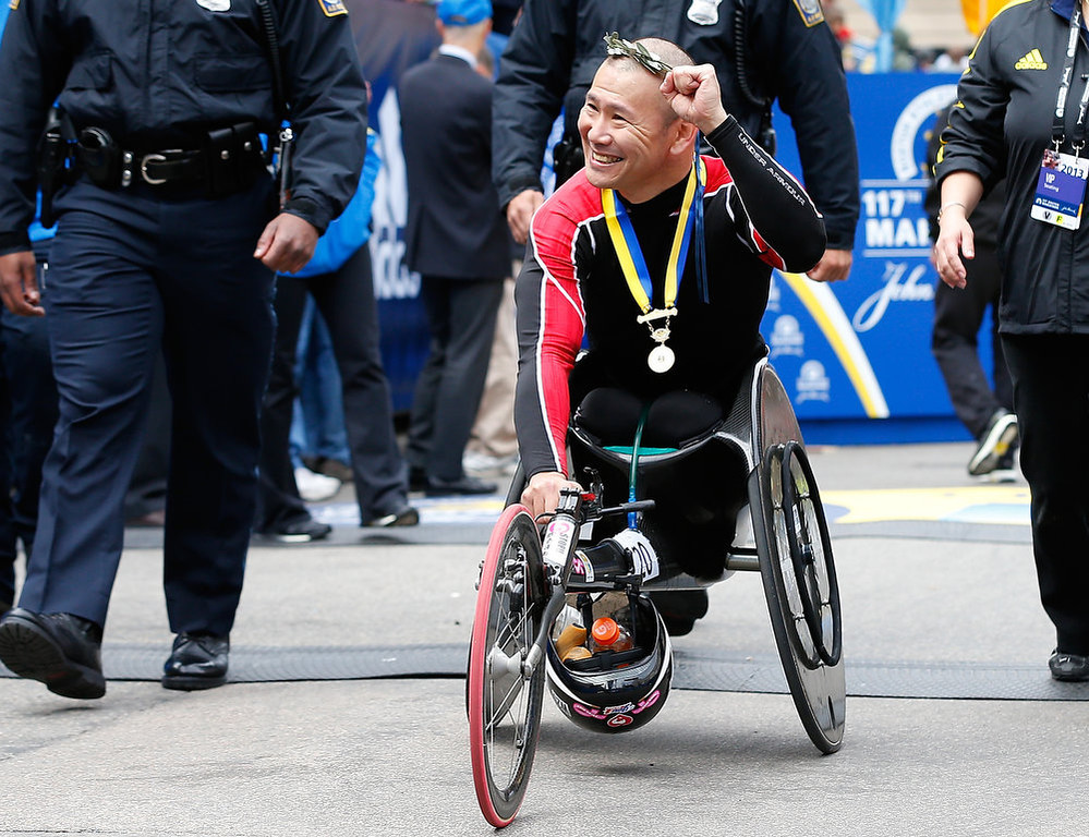 . Hiroyuki Yamamoto of Japan reacts after winning the men\'s wheelchair division of the 117th Boston Marathon on April 15, 2013 in Boston, Massachusetts.  (Photo by Jim Rogash/Getty Images)
