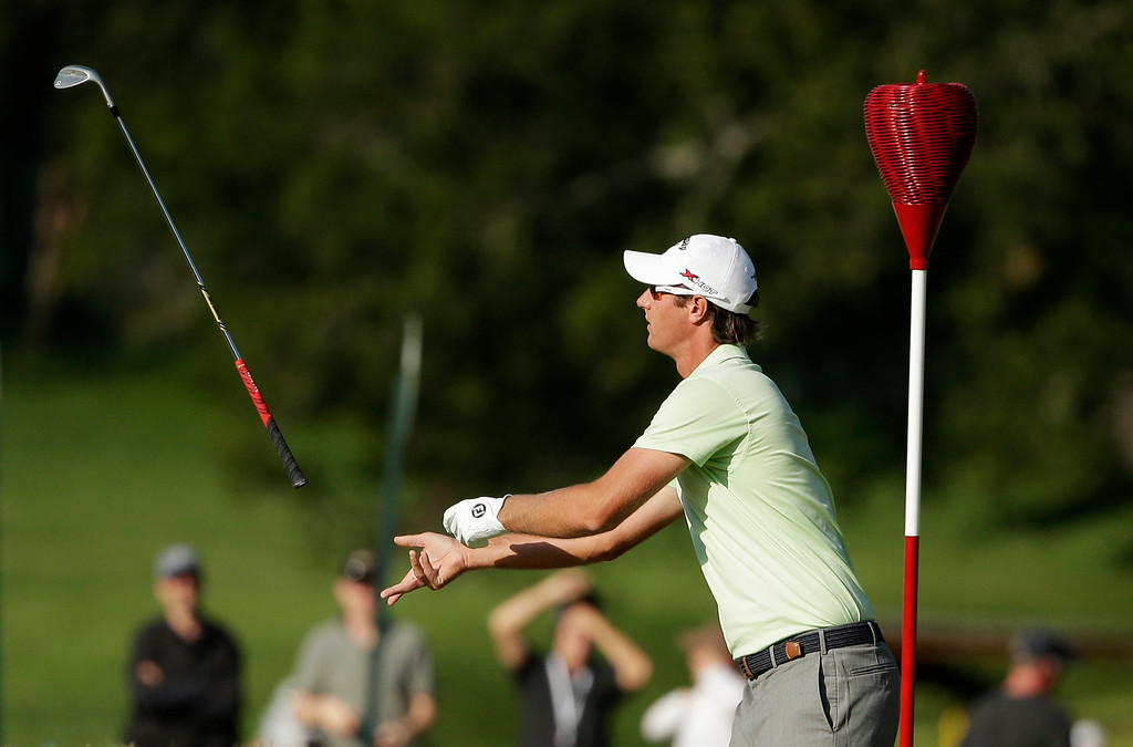 . Nicolas Colsaerts, of Belgium, tosses his club to his caddie after making a birdie on the eighth hole during the second round of the U.S. Open golf tournament at Merion Golf Club, Friday, June 14, 2013, in Ardmore, Pa. (AP Photo/Charlie Riedel)