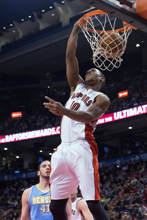 . Toronto Raptors\' DeMar DeRozan dunks against the Denver Nuggets during the first half of an NBA basketball game in Toronto on Tuesday, Feb. 12, 2013. (AP Photo/The Canadian Press, Chris Young)