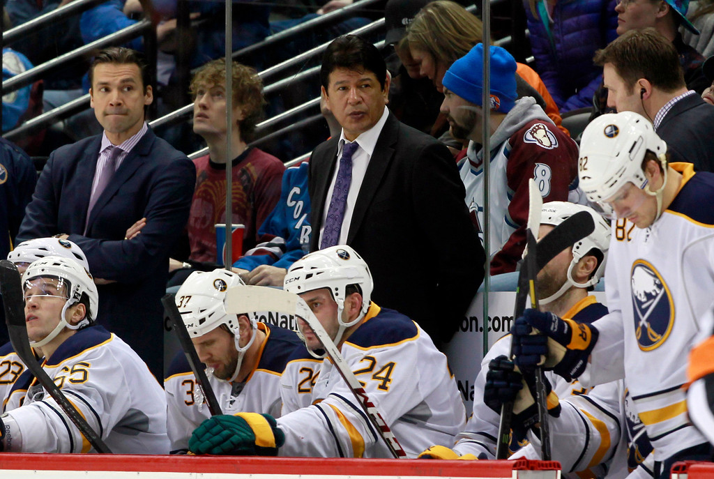 . Buffalo Sabres interim head coach Ted Nolan, top center, looks on as his team falls behind the Colorado Avalanche in the third period of the Avalanche\'s 7-1 victory in an NHL hockey game in Denver, Saturday, Feb. 1, 2014. (AP Photo/David Zalubowski)