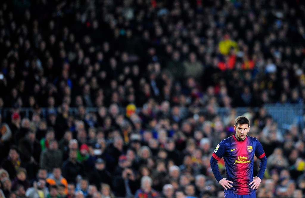 . FC Barcelona\'s Lionel Messi from Argentina looks on during a Spanish La Liga soccer match against Espanyol at the Camp Nou stadium in Barcelona, Spain, Sunday, Jan. 6, 2013. (AP Photo/Manu Fernandez)