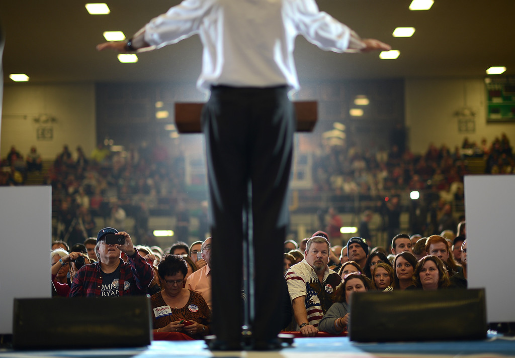 . Supporters listen to US Republican Presidential candidate Mitt Romney during a rally at the Veterans Memorial Coliseum in Marion, Ohio, October 28, 2012. (EMMANUEL DUNAND/AFP/Getty Images)