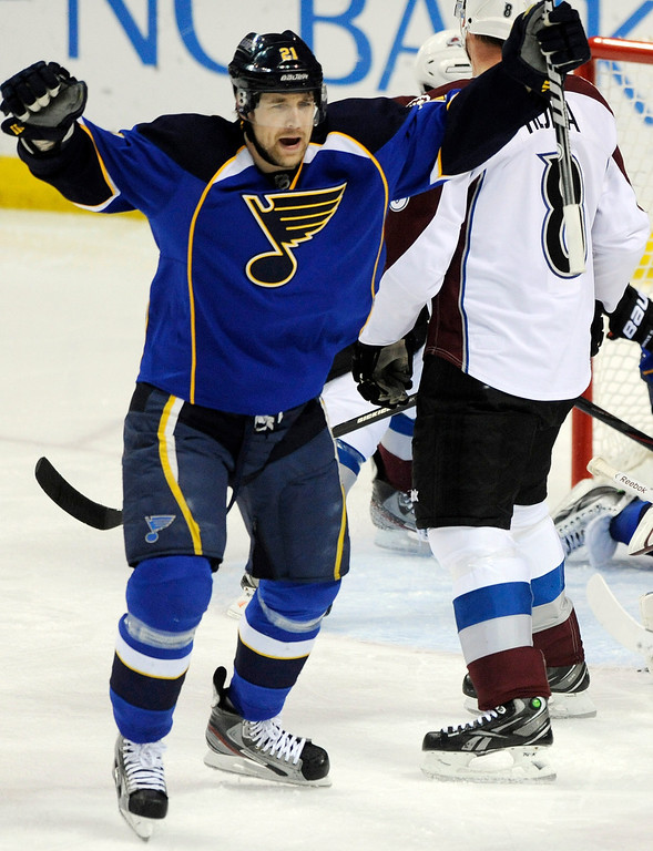 . St. Louis Blues\' Patrik Berglund (21), of Sweden, celebrates his goal in front of Colorado Avalanche\'s Jan Hejda (8), of Czech Republic, in the second period of an NHL hockey game Tuesday, April 23, 2013, in St. Louis. (AP Photo/Bill Boyce)