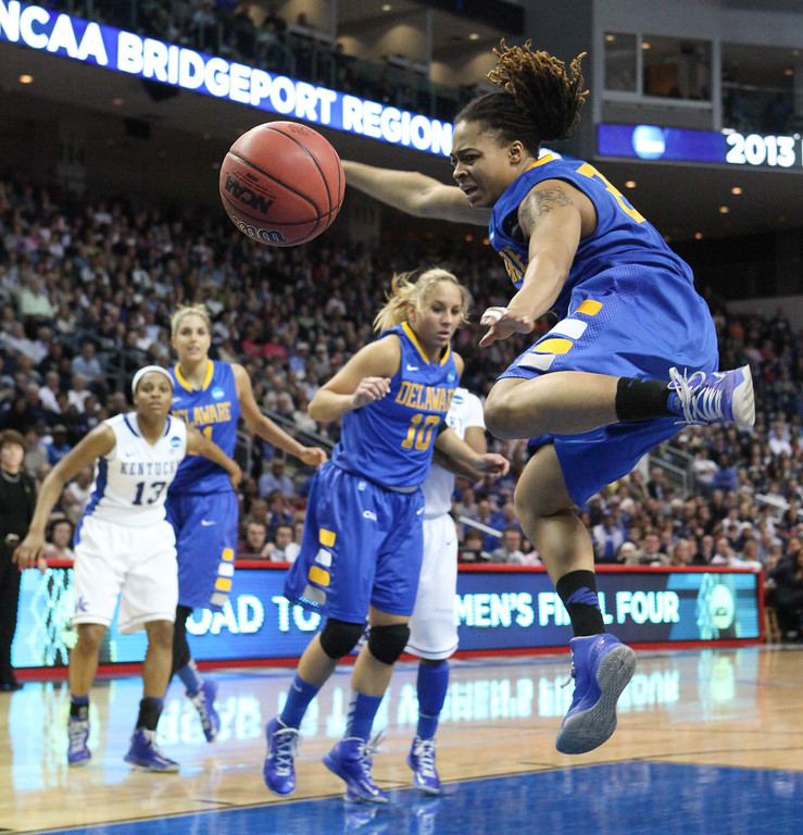 . Delaware guard Trumae Lucas tries to get the rebound against Kentucky during an NCAA women\'s college regional semifinal basketball game in Bridgeport, Conn., Saturday, March 30, 2013. Kentucky won 69-62. (AP Photo/The Wilmington News-Journal, Suchat Pederson)