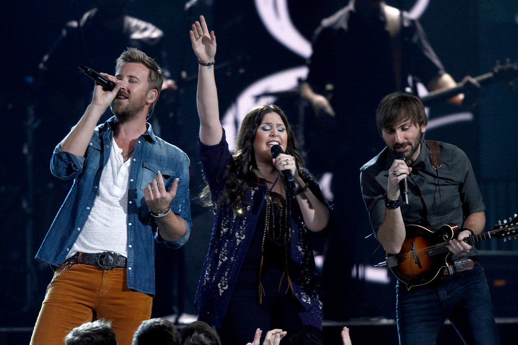 . Lady Antbellum, from left, Charles Kelley, Hillary Scott, and Dave Haywood, perform at the 47th annual CMA Awards at Bridgestone Arena on Wednesday, Nov. 6, 2013, in Nashville, Tenn. (Photo by Wade Payne/Invision/AP)