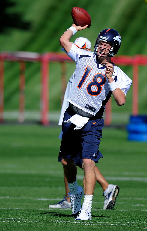 . Denver Broncos quarterback Peyton Manning (18) throws a pass during practice September 9, 2013 at Dove Valley. (Photo by John Leyba/The Denver Post)