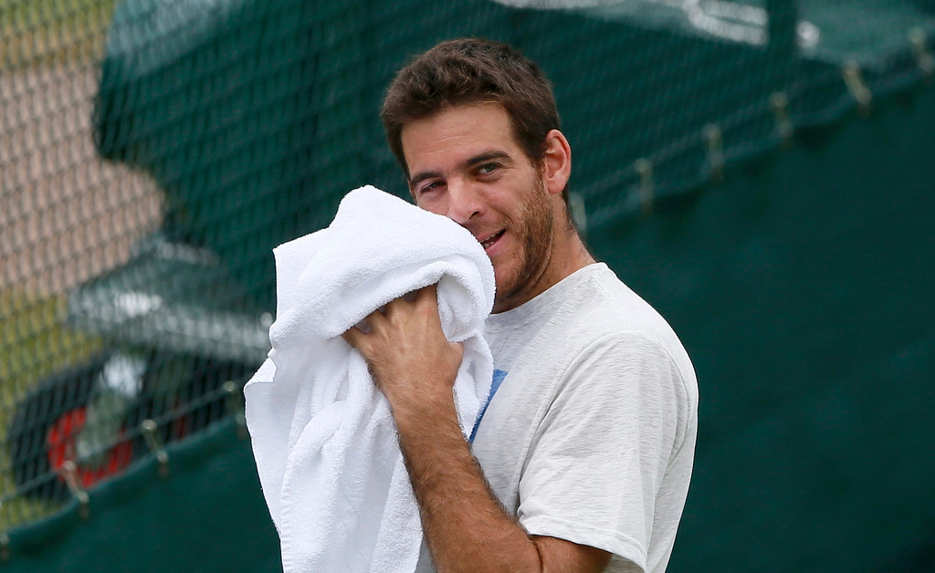 . Juan Martin del Potro of Argentina wipes his face during a training session on a practise court at the Wimbledon Tennis Championships, in London July 4, 2013.       REUTERS/Stefan Wermuth