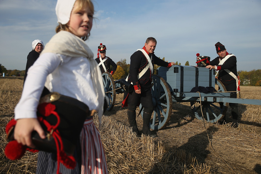 . Historical society enthusiasts in the role of French artillery soldiers fighting under Napoleon take arrive to re-enact The Battle of Nations on its 200th anniversary on October 20, 2013 near Leipzig, Germany. (Photo by Sean Gallup/Getty Images)