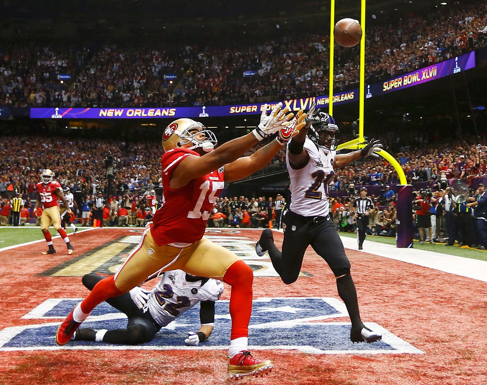 . San Francisco 49ers wide receiver Michael Crabtree (15) can\'t reach a pass while being covered by Baltimore Ravens cornerback Jimmy Smith (22) and Ed Reed during the fourth quarter in the NFL Super Bowl XLVII football game in New Orleans, Louisiana, February 3, 2013.   REUTERS/Jeff Haynes