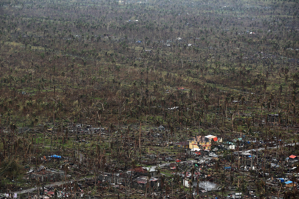 . A general view of the destruction in Tolosa on November 21, 2013 in Leyte, Philippines. Typhoon Haiyan which ripped through the Philippines over a week ago has been described as one of the most powerful typhoons ever to hit land, leaving thousands dead and hundreds of thousands homeless. Countries all over the world have pledged relief aid to help support those affected by the typhoon however damage to the airport and roads have made moving the aid into the most affected areas very difficult. With dead bodies left out in the open air and very limited food, water and shelter, health concerns are growing.  (Photo by Dan Kitwood/Getty Images)