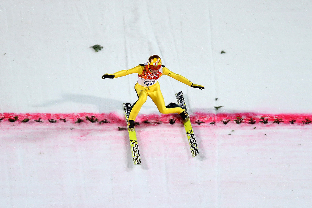 . SOCHI, RUSSIA - FEBRUARY 15:  Noriaki Kasai of Japan lands his jump during the Men\'s Large Hill Individual Final Round on day 8 of the Sochi 2014 Winter Olympics at the RusSki Gorki Ski Jumping Center on February 15, 2014 in Sochi, Russia.  (Photo by Julian Finney/Getty Images)