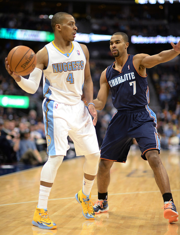 . Ramon Sessions of the Charlotte Bobcats (7) pressures Randy Foye of the Denver Nuggets (4) in the second half of the game. (Photo by Hyoung Chang/The Denver Post)